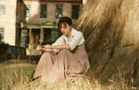Keira Knightley sitting by a tree