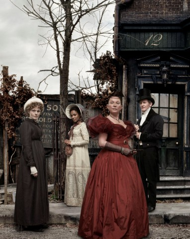 Maxine Peake, Freema Agyeman, Amanda Redman and Anton Lesser wearing period costumes standing in a street