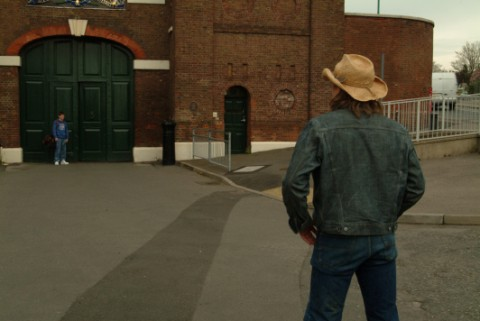 Ronnie (Christopher Fulford) and Bobby (Jack O'Connell) standing in front of Chatham Dockyards which doubles as a Prison