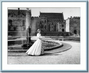 Black and white picture of Anne standing by the fountain at Penshurst Place