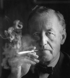 Ian Fleming smoking a cigarette