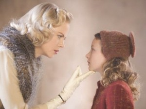 Nicole Kidman as Mrs Coulter and Dekota Blue Richards as Lyra