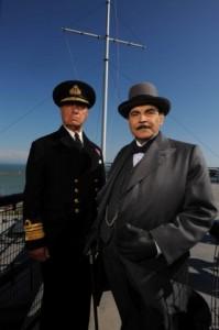 Poirot The Clocks L-R Geoffrey Palmer & David Suchet standing in front of a mast