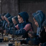Anne Hathaway as Fantine working in a factory