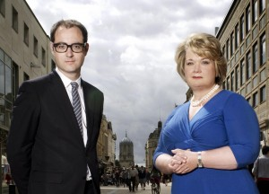 Superscrimpers presenters Harry Wallop and Mrs Moneypenny standing in a high street