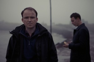 David Whitehead (Rory Kinnear) and Anthony (Al Weaver) standing at the misty marshes