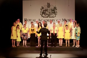Gareth Malone conducting the P&O choir as they stand on a stage
