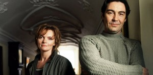 The Inspector Lynley Mysteries - Detective Barbara Havers (Sharon Small) and Detective Inspector Thomas Lynley (Nathaniel Parker) standing next to each other
