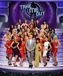 Paddy McGuiness surrounded by the 30 girls on the steps of the Take Me Out set