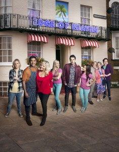 Edge of Heaven cast - L-R LAURA CHECKLEY (Ann-Marie) NITIN KUNDRA (Tandeep) CAMILLE CODURI (Judy) JUSTINE CAIN (Carly) BLAKE HARRISON (Alfie) LOUISE LYTTON (Michelle) ADRIAN SCARBOROUGH (Bald Gary) MARCIA WARREN standing in front of the B&B