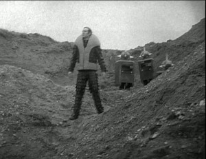 Screenshot at Wrotham Quarry screenshot - a man standing with the Quarks behind him