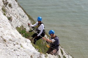 Denise Lewis, Will Tebbutt (L-R) abseiling for rock samphire off the White Cliffs of Dover