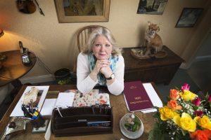 Lisa Holloway sitting at a desk