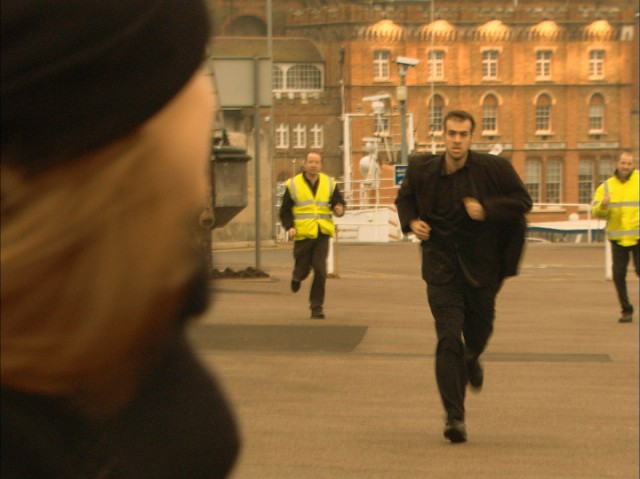 Chloe Sirene and Freddie Connor running along Ramsgate Harbour with two security guards running after them