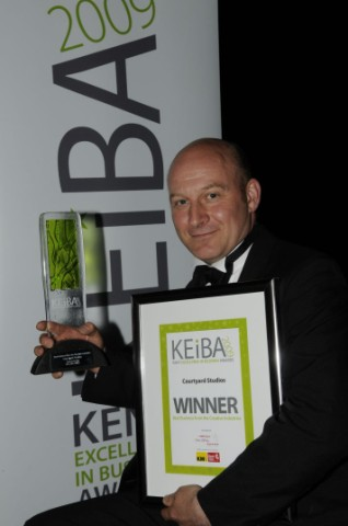 Paul Dixon holding the Creative Industries Award