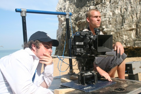 Joesph Martin the Director and the Director of Photography Mike linforth sitting by a camera watching the action