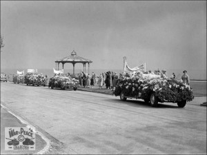 Parade on the Leas during filming of Lady Godiva Rides Again Folkestone July 1951- row of cars driving along the road