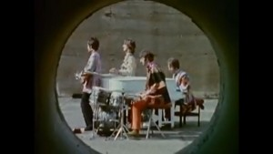 Magical Mystery Tour Screenshot - the band playing instruments on concrete runway