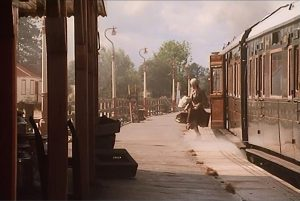 Kent and East Sussex Railway station screenshot - a woman getting off a train