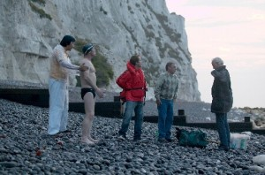 Frank (Peter Mullan) at the foot of the White Cliffs of Dover with his friends preparing for the swim