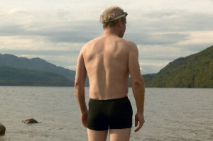 Frank (Peter Mullan) looking out at the sea with mountains in the background