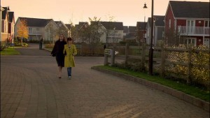 "Screenshot of people walking at the housing development ""Meadowlands"" filmed at Leybourne Lakes"