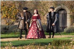 Mary Boleyn (Scarlett Johansson) in the Grounds of Penshurst Place walking away from a wooden door