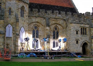 Behind the scenes at Penshurst Place- lighting equipment and stage set up against church wall
