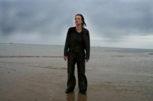 Alex Reid standing on a beach