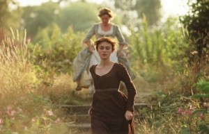 Elizabeth Bennett (Keira Knightley) and Mrs Bennet (Brenda Blethyn) running down some steps in a garden, plants and shrubbery either side of path