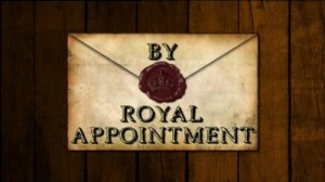 By Royal Appointment written in a cartoon of an old envelope on a wooden background