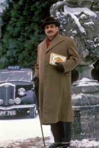 David Suchet as Hercule Poirot in a Snowy Chilham with a black classic car behind him