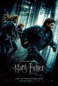 Rupert Grint, Emma Watson and Daniel Radcliffe running through a dark forest. Film title Harry Potter and the Deathly Hallows Part 1 is in silver underneath