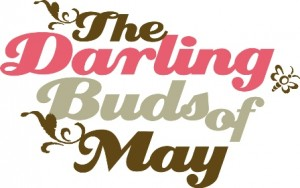 The Darling Buds of May Logo- The Darling Buds of May written in brown, pink and grey