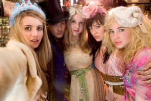 Emma Roberts (Poppy), Linzey Cocker (Josie), Sophie Wu (Kiki), Kimberley Nixon (Kate) and Juno Temple (Drippy) all dressed in fancy dress posing at the camera.