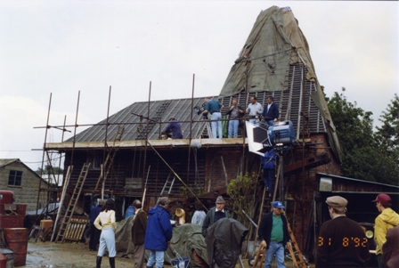 Buss Farm Oast being worked on before filming, scaffolding and crew surround it