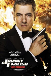 Rowan Atkinson as Johnny Engish holiday a gun with fire behind him, Johhny English Reborn written underneath