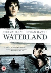 Waterland Movie Poster- top image of a man standing in front of marshes facing the camera, bottom image of man and women embracing as a boy in a boat sits in the water behind them. Waterland is written in the middle of the images.