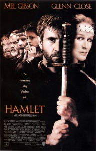 Hamlet Movie Poster- Hamlet holding a sword up to his face, other characters stand behind him looking away from the camera. Hamlet is written in orange.