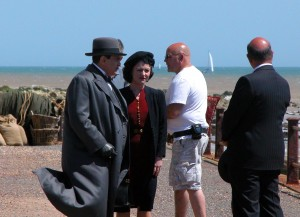 Poirot (David Suchet) and Shelia Webb (Jaime Winstone) on set