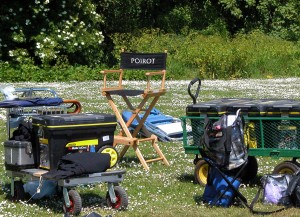 "Behind the scenes picture - chair with ""Poirot"" on it surrounded by camera equipment"