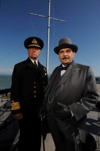 Poirot The Clocks L-R Geoffrey Palmer & David Suchet standing in front of a mast