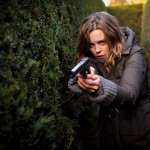 Sam Hunter (Melissa George) with a gun pointed at the camera