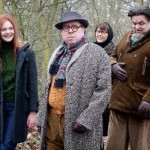 L-R Elle Fanning, Timothy Spall, Annette Bening and Oliver Platt all staring at the camera in front of some trees