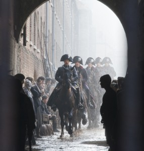 Les Misérables Javert (Russell Crowe) leading his policemen on horses going through the streets