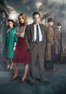 Murder on the Home Front characters standing on a London Street facing the camera