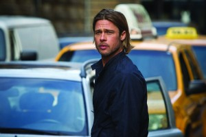 World War Z - Gerry Lane (Brad Pitt) standing in front of a queue of taxis