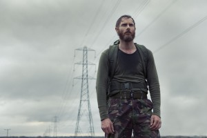 Stephen (Sean Harris) in an army uniform with pylons behind him