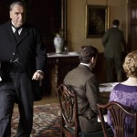 Jim Carter as Carson - waiting on the family sat at the table