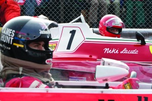 Chris Hemsworth as James Hunt and Daniel Bruhl as Niki Lauda sitting in F1 race cars